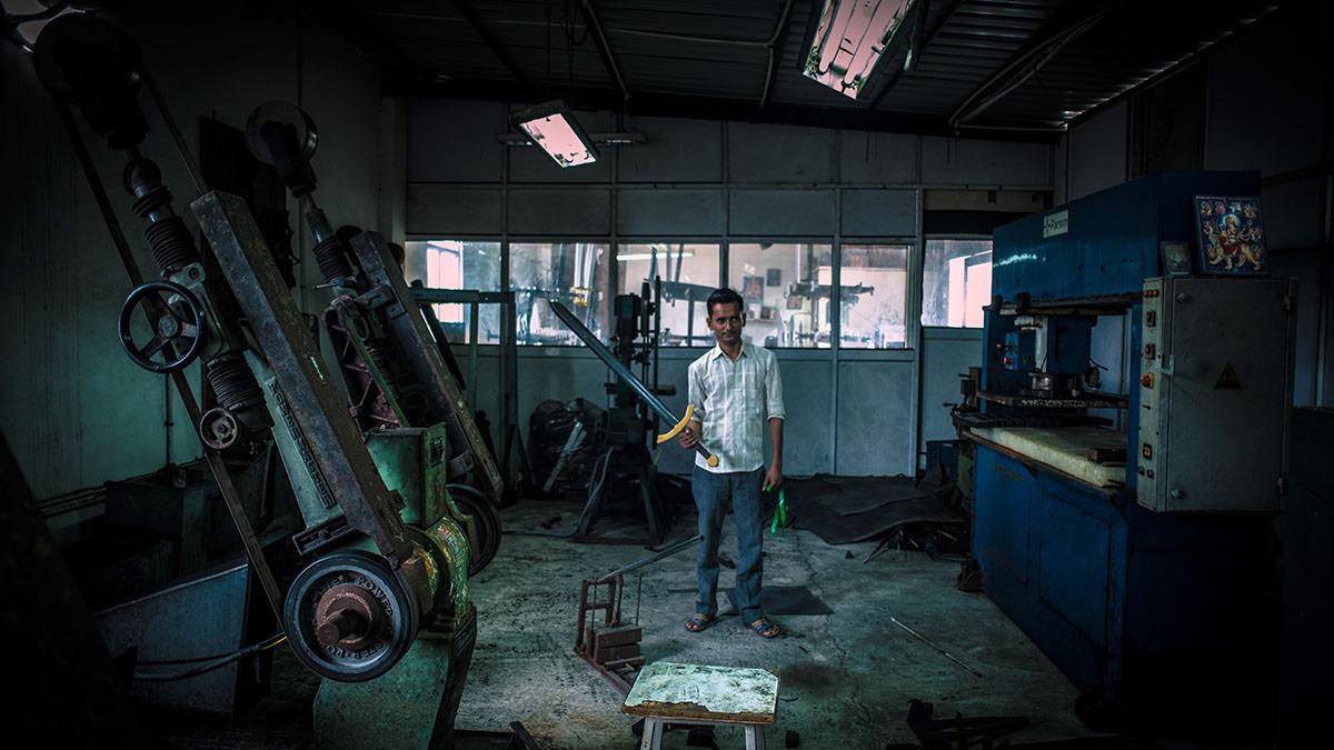 A worker holds a foam replica of Jon Snow's Valyrian Steel sword