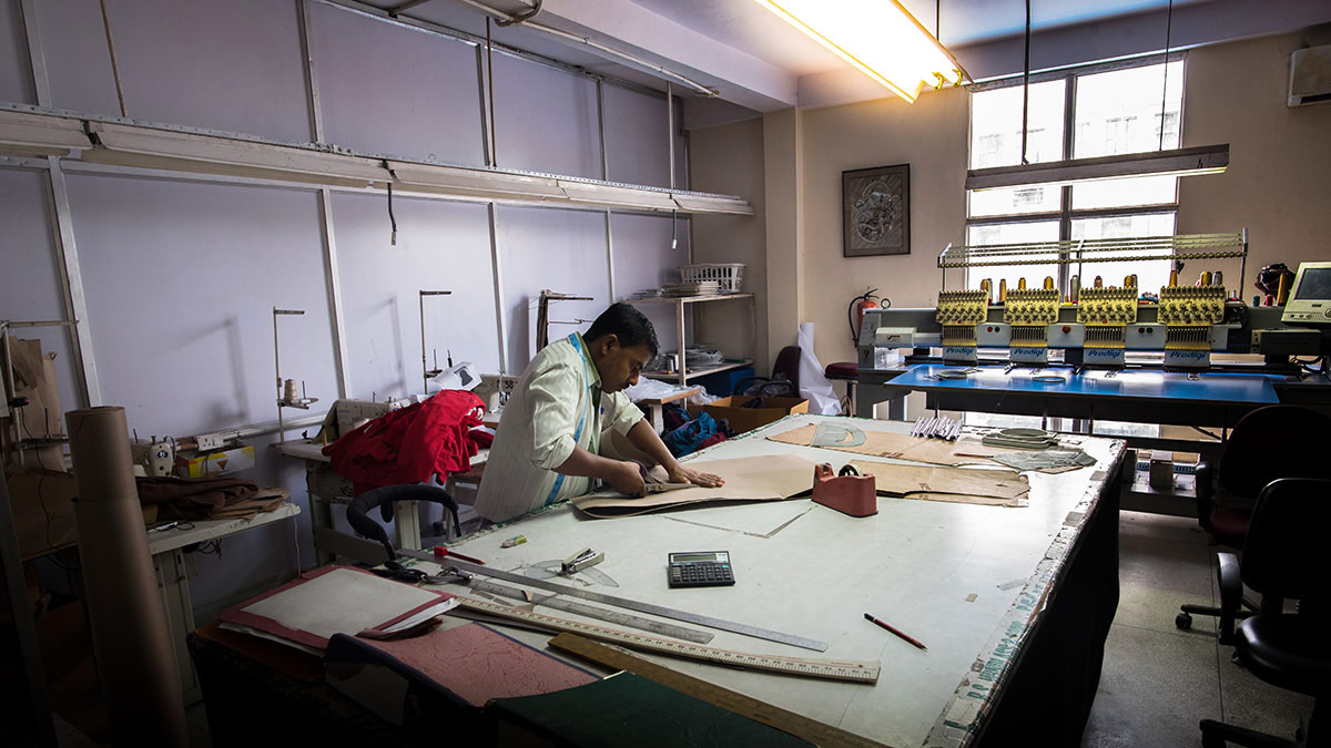 A skilled worker scissors his way into a complicated pattern