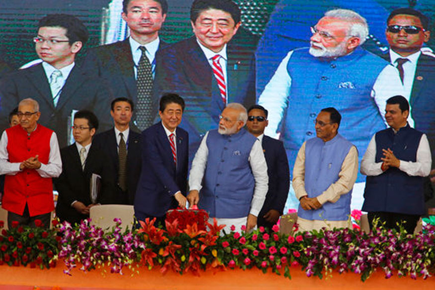 Japanese PM Shinzo Abe and PM Narendra Modi, press a button to launch a high speed rail project in Ahmadabad. (AP Photo)