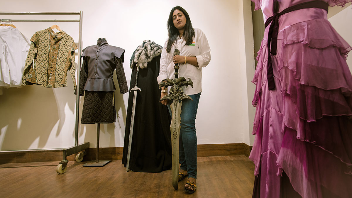 Rashi Goil posing with Game of Thrones costumes and weapons
