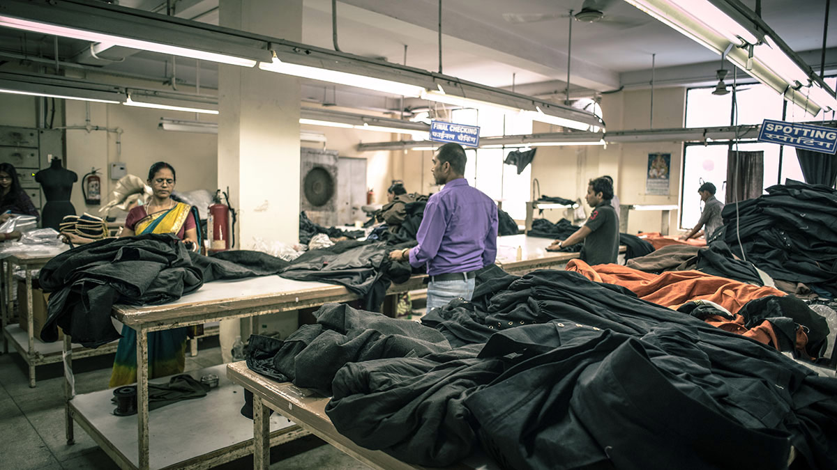 Workers checking fabric