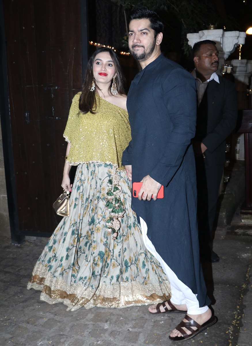 Rohit Dhawan and his wife Jaanvi Desai Dhawan pose for a photo during Anil Kapoor's Diwali party hosted at his residence in Mumbai on October 19, 2017. (Image: Yogen Shah)