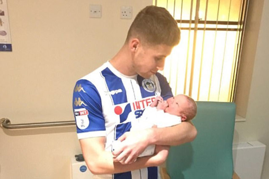 Wigan's Colclough Scores Two, Then Rushes to Hospital for Son's Birth