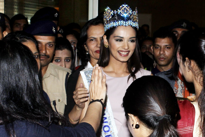 (Photo: Manushi Chhilar receives a warm welcome at Mumbai airport Yogen Shah)