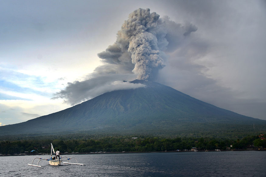 flights resume as bali s volcano hit airport gets back to