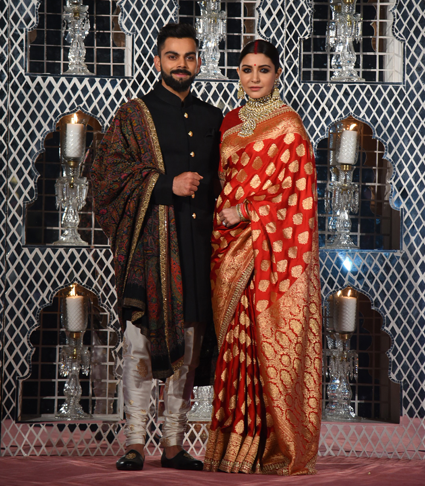 Virat Kohli and Anushka Sharma look gorgeous at the reception in Delhi