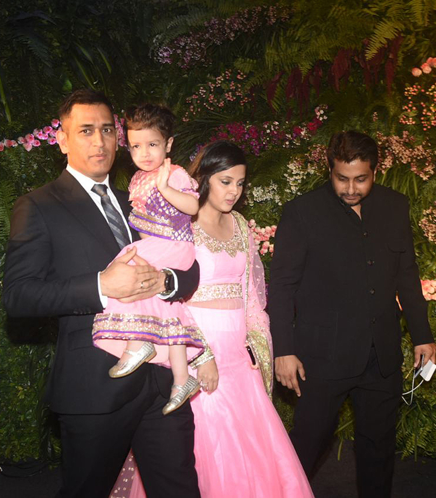 MS Dhoni with Sakshi and Ziva at the wedding reception of Virat Kohli and Anushka Sharma held at St. Regis Hotel in Mumbai on December 26, 2017. (Image: Yogen Shah)