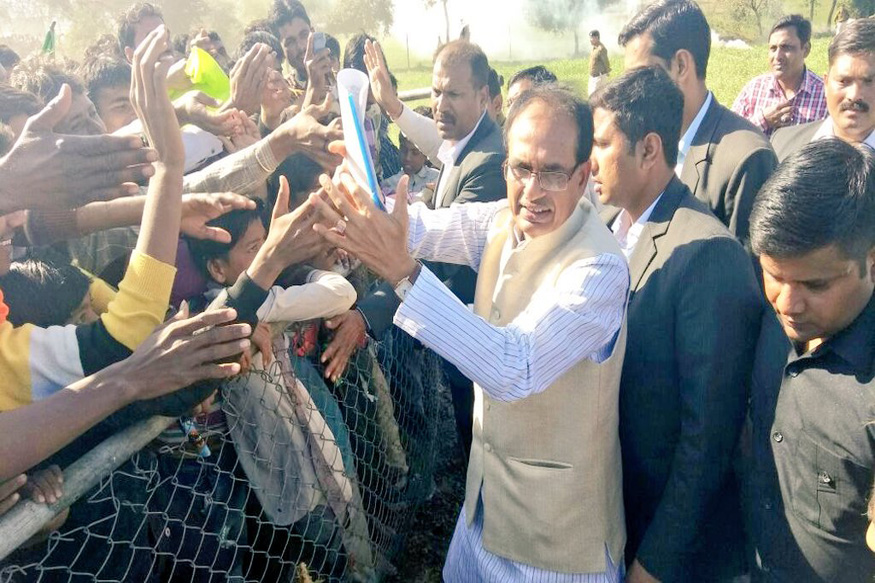 Mp cm chouhan flies home from gujarat without attending