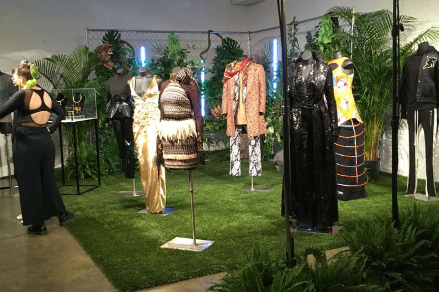 """Fashion from a small collection inspired by the upcoming superhero film """"Black Panther,"""" are displayed in New York. The designs were created by the brands Chromat, Cushnie et Ochs, Fear of God, LaQuan Smith, Ikire Jones, Sophie Theallet and TOME, with capsule collections by jewelry designer Douriean Fletcher and shoe designer Aurora James of Brother Vellies. (AP Photo/Leanne Italie)"""