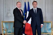 French President Emmanuel Macron meets Russian President Vladimir Putin in France