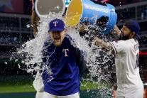 Baseball players get doused with ice water