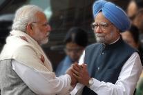 Narendra Modi, Manmohan Singh Shake Hands at Parliament