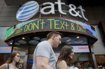 Kaine, Trump, U.S. Lawmakers Raise Concerns Over AT&T-Time Warner Deal