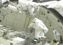Spatula escapes <I>Discovery</I> spacewalkers
