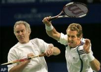 McEnroe makes winning return to tennis