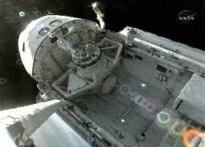 Discovery astronauts finish spacewalk