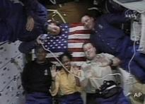 <I>Discovery</I> crew set for 4th spacewalk