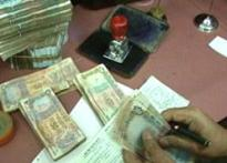 Tax on cash withdrawals may stay