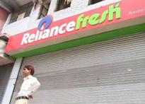 Reliance, Subhiksha stores face closure, ire of traders