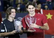 Federer blasts Ferrer to win fourth Masters Cup
