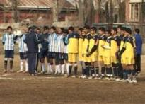 Kashmir youths enjoy soccer in sub-zero temperature
