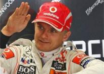 McLaren's Kovalainen takes pole at Silverstone