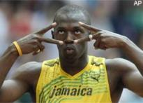 Bolt's double bid in top gear, Wariner and Merritt cruise