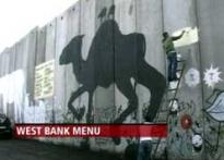 Eatery paints menu on wall separating Israel, West Bank