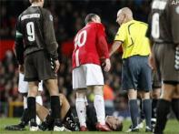 Rooney escapes ban for Aalborg stamp