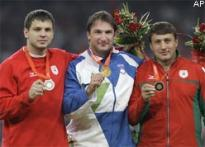 IOC strips 2 Belarusians of Olympic hammer medals