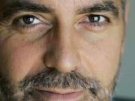 U2's Bono quizzes Clooney on politics, acting