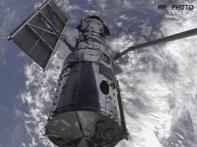 Atlantis astronauts re-capture Hubble telescope
