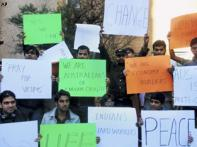 Tired of words, Indian students want Oz govt to act