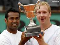 <a href='http://ibnlive.in.com/photogallery/1386.html'>Photogallery: Game, set, title to Paes-Dlouhy</a>