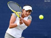 Paes crashes out, Sania stays afloat in doubles
