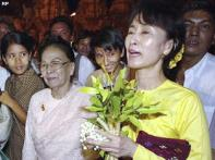 Myanmar halves Suu Kyi's sentence, sends message