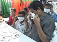 Party swine flu masks for Maharastra bypolls voters