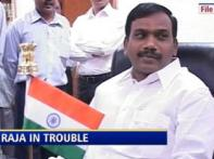 CBI raids his Ministry; Raja fights to keep his job