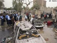 Blasts in Baghdad target govt buildings, over 100 killed