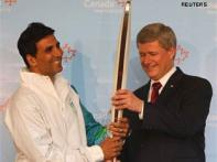 Canadian PM gives Olympic Torch model to Akshay