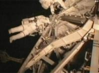 Atlantis astronauts finish first spacewalk