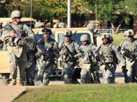 US soldier in custody after shootout, America in shock