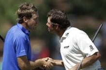 Poulter, Westwood in Masters lead
