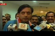 No clean chit to Tharoor yet; Oppn cry foul