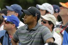 Woods back, two shots behind Couples