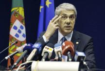 Greece goes bust, Portugal tightens its belt