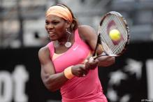 Williams sisters advance at Italian Open