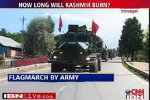 Srinagar tense, Army conducts flag march