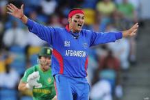 Hassan leads Afghan rout of Scotland
