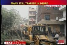 Delhi building collapse: owner booked